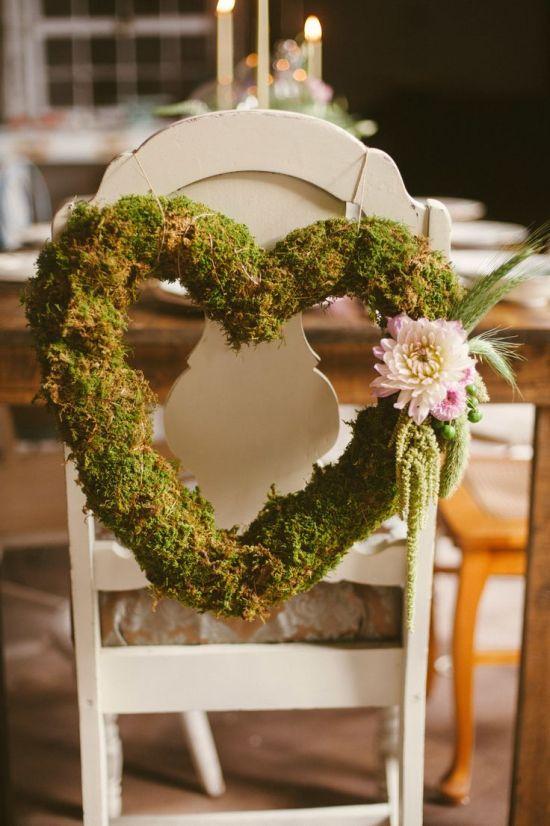 Woodland wedding moss heart chair decoration